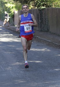 Steve on his way to winning at about 9.3K (photo courtesy of Barry Cornelius)